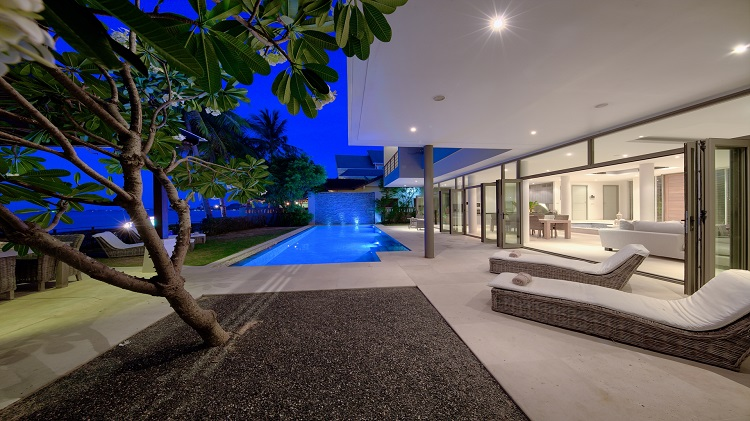 Koh Samui Luxury Villa for sale; Koh Samui Beach front Villa for Sale, Pool deck at dusk,